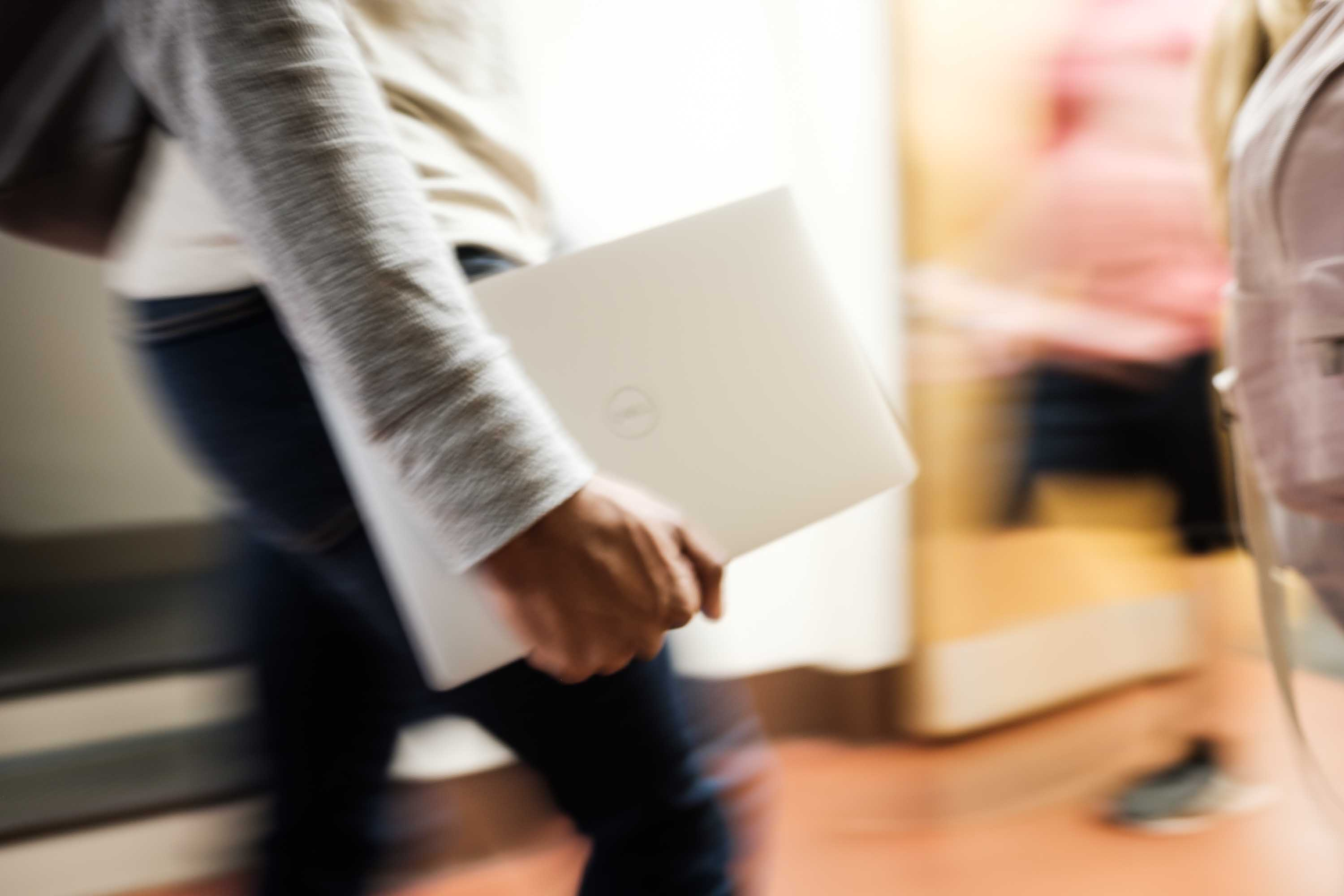 Student carrying a WakeWare laptop
